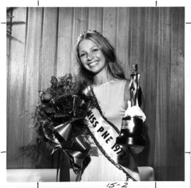 Regina Helgason, Miss P.N.E. 1972, posing with flowers and trophy
