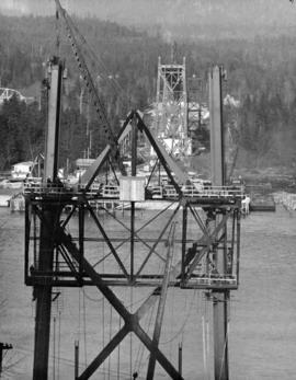 Taken by long-distance lens from below cable anchorage on South Shore.  North Shore steel is goin...