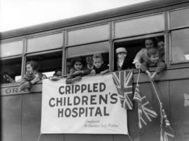 [Children waving flags from a bus during visit of King George VI and Queen Elizabeth]