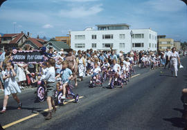 Parade, on Cornwall Street, Haddon Play Group children on tricycles and spectators