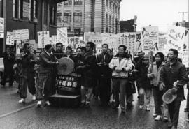 Men marching in parade on East Pender Street to protest the construction of a new firehall at Pen...