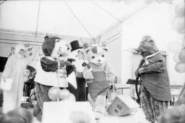 Tillicum and group of mascots on stage