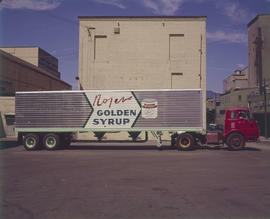 Rogers Golden Syrup branded bulk delivery truck in loading area