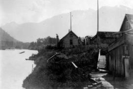 [Buildings beside a river]