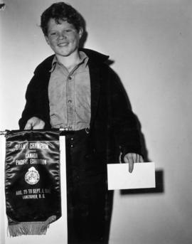 Young boy with Canadian Pacific Exhibition prize