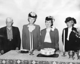 [Mrs. Margaret McNeil and others celebrate her birthday with a cake sent from Vancouver, B.C.]