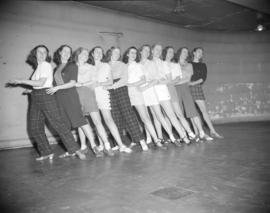 [Dancers practicing a dance routine]