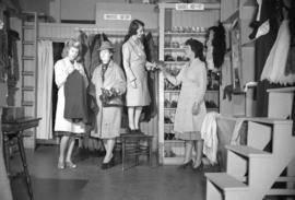 [Women shopping at a clothing and shoe store]