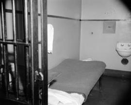 [Interior view of a jail cell at Oakalla prison]