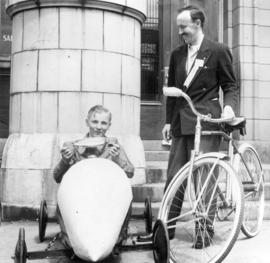 [William D. McLaren beside a boy in a go-cart]