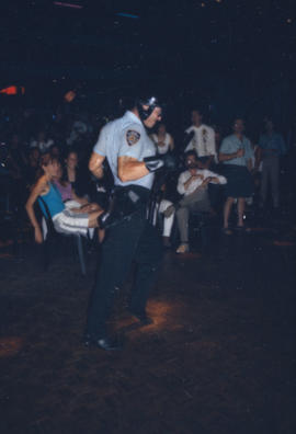 Performer wearing police costume
