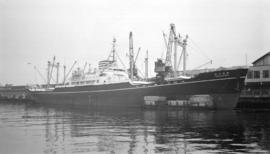 "M.S. Kamogawa Maru [at dock, at Pier ""B"", with barges alongside]"