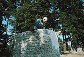 Michael Prentice working atop sculpture at early stages