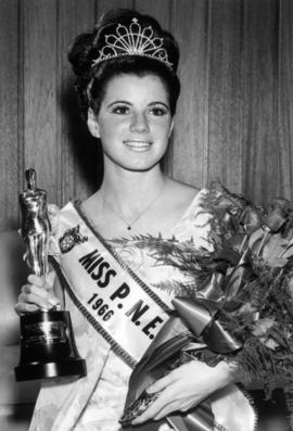 Judy Collyer, Miss P.N.E. 1966, poses with flowers and trophy