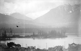 [View of downtown houses, part of Stanley Park, and the North Shore mountains from the roof of Ma...
