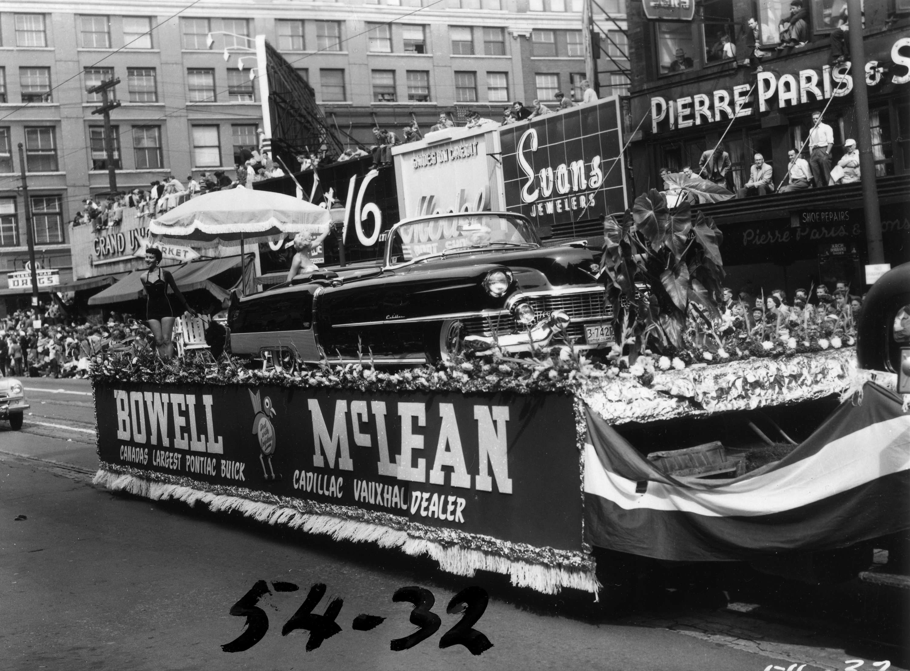 Bowell McLean car dealership float carrying Cadillac in ...