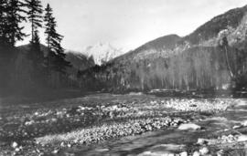 "[The Capilano River with ""The Lions"" in the background]"