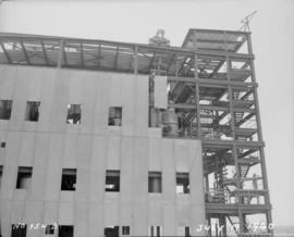 Construction of pan house: girders and wall panels at southeast corner