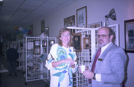 Unidentified man and woman standing in front of gift display