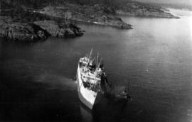 [Aerial view of listing steamship]
