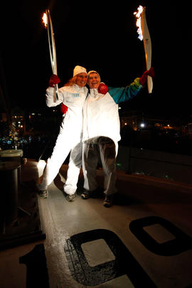 Day 22 Torchbearer 139 Elizabeth Ross passing the flame to torchbearer 140 Sherry Ritcey in Lunen...