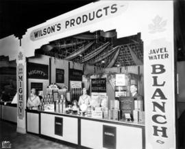 Wilson's Products display of Mighty and Kleenwell cleaning products