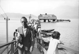 [People exiting ferry wharf, Harrison Lake]