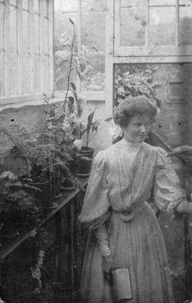 [Ethel Bryant in a greenhouse]