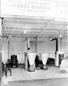 C.J. Milligan Co. display of sawdust burning furnaces