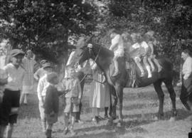 Anglo-Canadian Warehouse picnic [six children on horse]
