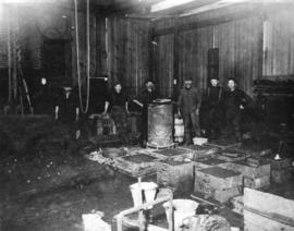 [Workers in an iron foundry]