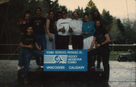 Group standing with Rocky Mountain Sound sign