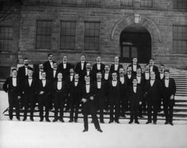 Western Triple Men's Choir in front of King Edward High School with Mr. Hyslop, the conductor