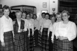 Group of women wearing tartan skirts