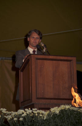 Gordon Campbell speaking at the lighting of the Peace Flame Monument ceremony