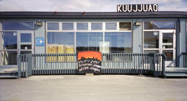"Building with ""Welcome to Kuujjuaq"" sign"