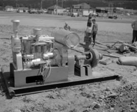 [Pump equipment and generator on ground used for loading water onto water bomber]
