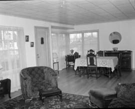 [Interior view of a house, showing the dining room and living room]