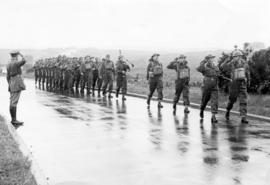 "[Camerons' unit of the 6th Canadian Infantry Brigade returning from a ""Cobra"" exer..."