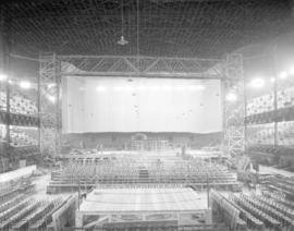 [Photograph of arena stage construction]