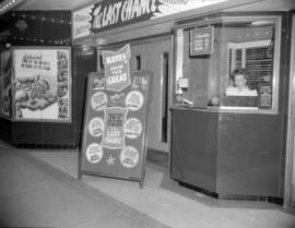 "[Strand Theatre box office showing advertising for ""The Last Chance"""