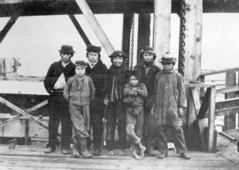 Nanaimo Indians [standing on a dock]