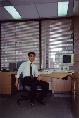 Paul Yee in office at Archives of Ontario