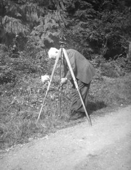 [John Rodger Burnes setting up a survey point on Hoskins Road]