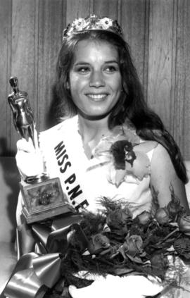 Judy Stewart, Miss P.N.E. 1971, posing with flowers and trophy