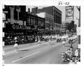 Majorettes and pipe band in 1956 P.N.E. Opening Day Parade