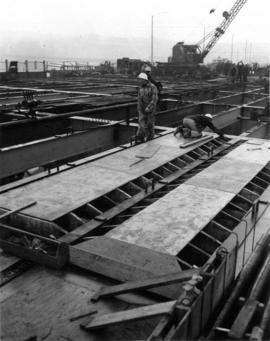 Forms for the deck [men working on bridge deck]
