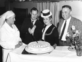 [Miss Margaret McNeil and others cut a diamond jubilee cake for the patients of Shaughnessy Hospi...