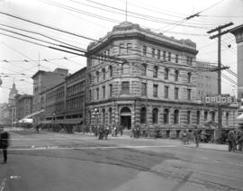 [Bank of Montreal and other businesses on] Hastings looking west from S.E. corner of Richards