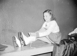 Miss Patricia Burley putting on skates